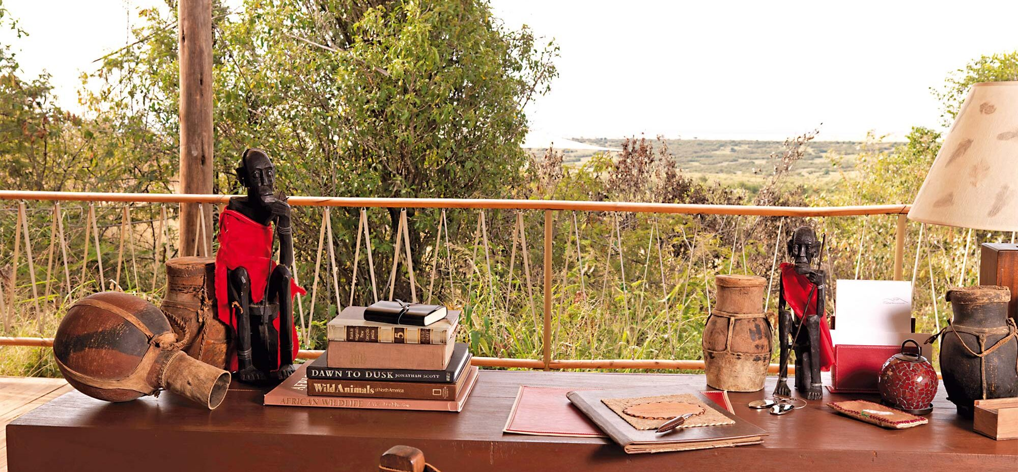 A close up of a desk with African decor overlooking the conservancy